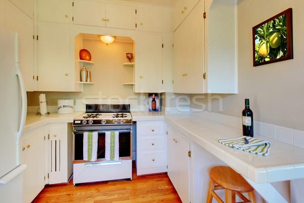 Branco cozinha bege paredes cereja piso de madeira Foto stock © iriana88w