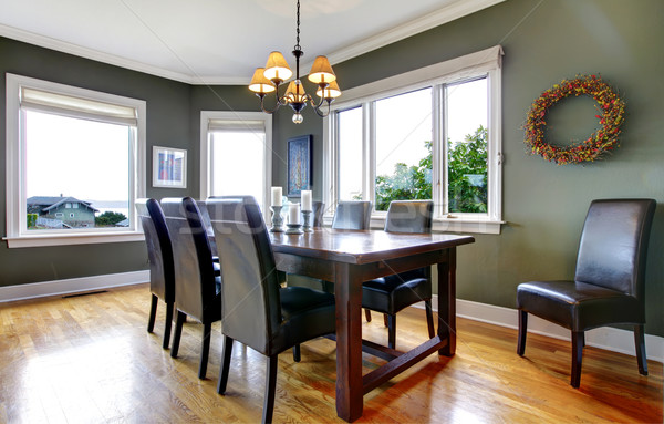 Large green dining room with leather chairs and large windows. Stock photo © iriana88w