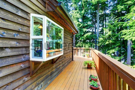 Cozy log cabin style house exterior.  Stock photo © iriana88w