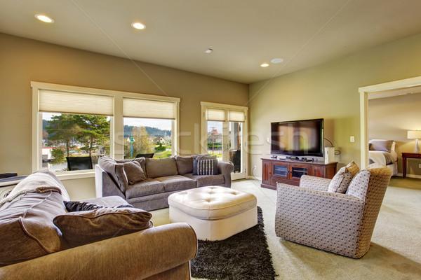 Secondary living room with carpet and windows. Stock photo © iriana88w