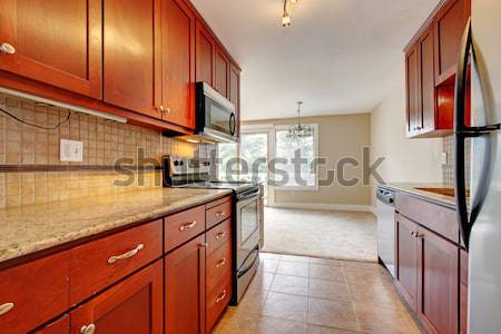 Simple dark cherry kitchen. Stock photo © iriana88w