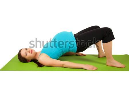 Zwangere jonge vrouwen groene yogamat Stockfoto © iriana88w