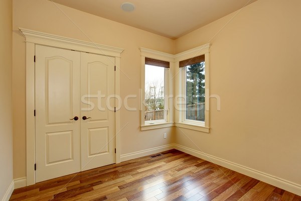 Unfurnished room with hardwood floor. Stock photo © iriana88w