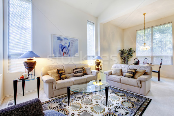 Bright white and blue living room with glass coffee table Stock photo © iriana88w