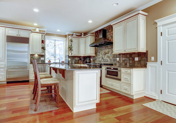 Large white luxury kitchen with cherry hardwood. Stock photo © iriana88w