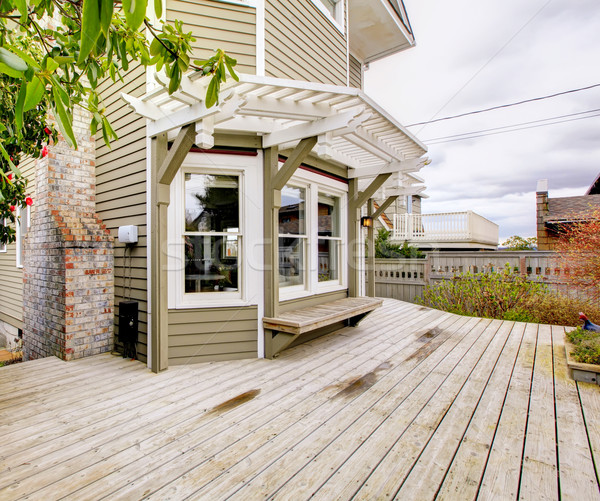 Spring backyard with house with large deck. Stock photo © iriana88w