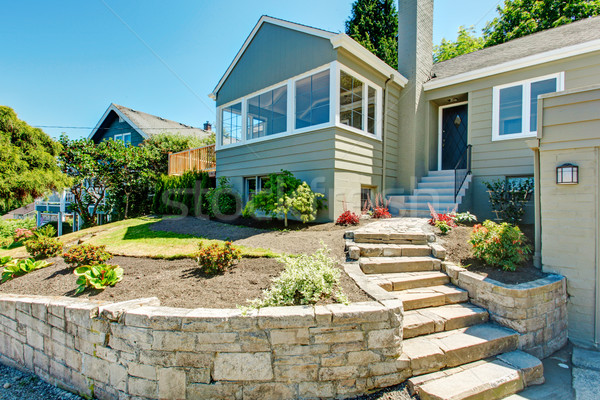 Front yard landscape with stone trim. House exterior Stock photo © iriana88w