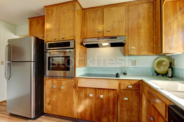 Wood kitchen with blue tiles. Stock photo © iriana88w