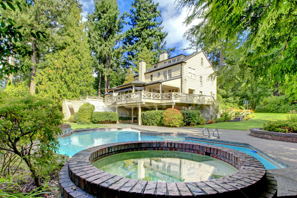 Large brown house exterior with summer garden with pool. Stock photo © iriana88w