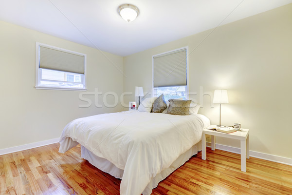 Simplistic white and brown bedroom interior with hardwood floor  Stock photo © iriana88w