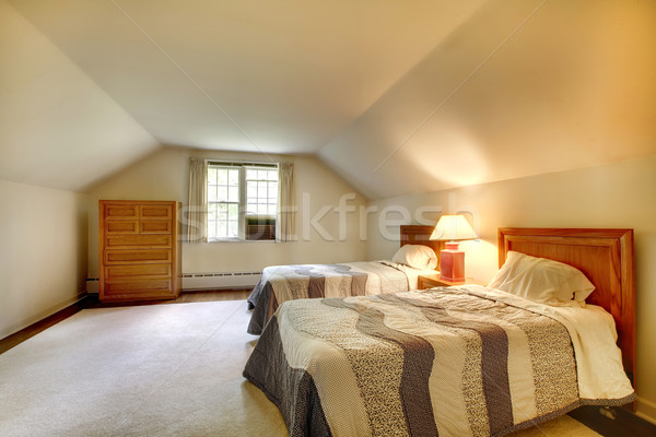 Attic bedroom with simple furniture and vaulted ceiling. Stock photo © iriana88w