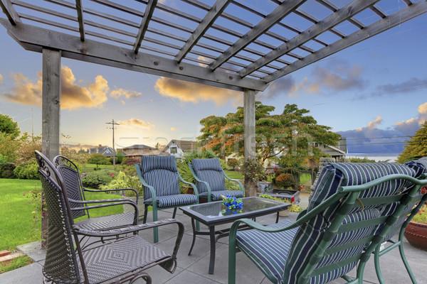 Cozy garden gazibo deck with chairs. Stock photo © iriana88w