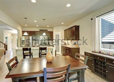 Stock photo: Modern kitchen area with wine racks