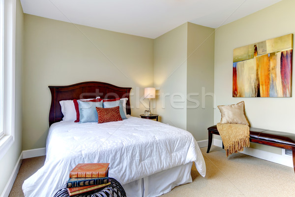 Bedroom with white bedding, green walls and nice decor. Stock photo © iriana88w