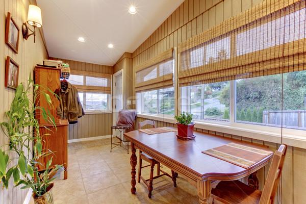 Bright sunroom with many windows on the back of the house.  Stock photo © iriana88w