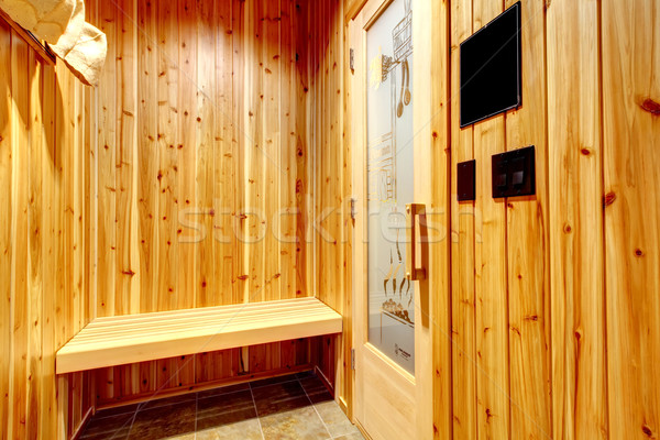 Home sauna with cedar wood walls and bench. Stock photo © iriana88w
