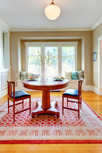Beautiful decor of dining room with beige, blue and red. Stock photo © iriana88w