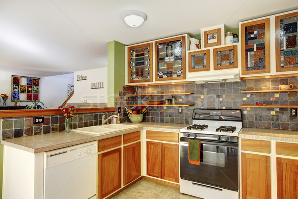 Bright kitchen interior with brown tile and colourful cabinets w Stock photo © iriana88w