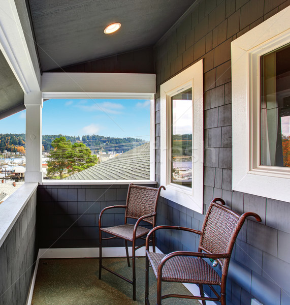 Covered porch of the blue siding home with two chairs. Stock photo © iriana88w