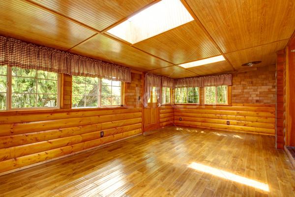 Bright empty log cabin house interior with skylights Stock photo © iriana88w