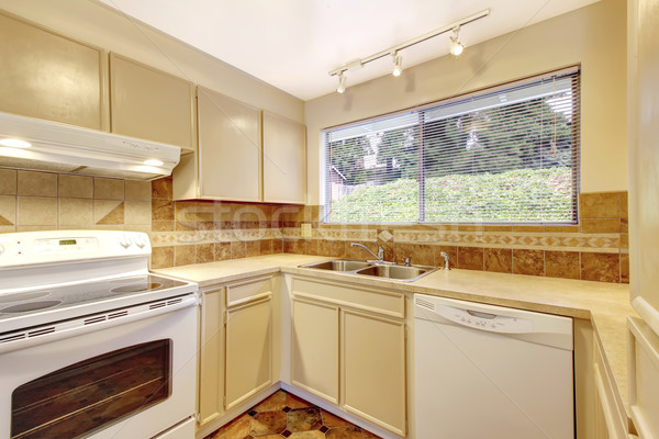 Simplistic kitchen room interior with beige cabinets and tile.  Stock photo © iriana88w