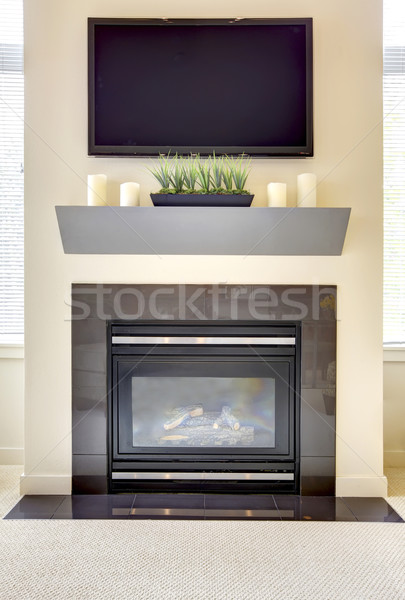 Modern new fireplace with large TV. Stock photo © iriana88w