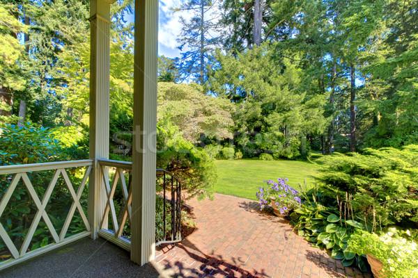Front porch house exterior with summer garden. Stock photo © iriana88w