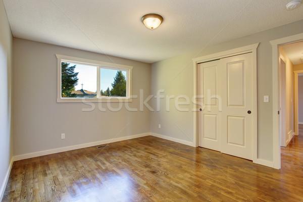 Simplistic hardwood bedroom. Stock photo © iriana88w