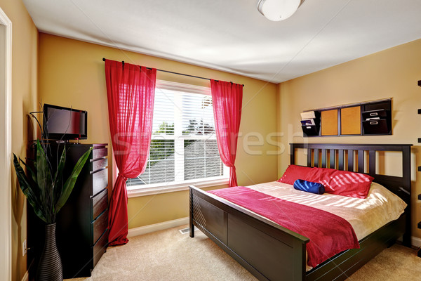 Simple yet practical bedroom design with red curtains Stock photo © iriana88w