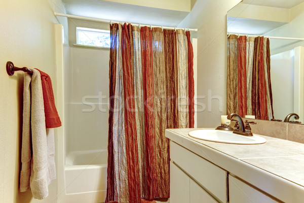Simple bathroom with red and browns colors in shower curtain and Stock photo © iriana88w
