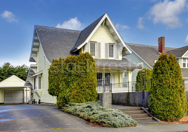 Craftsman style yellow house exterior. Stock photo © iriana88w