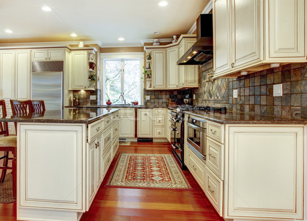 Large luxury white kitchen with cherry hardwood. Stock photo © iriana88w