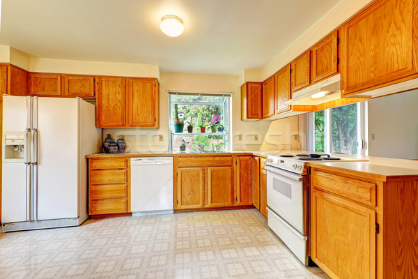 Kitchen room with maple cabinets and white appliances Stock photo © iriana88w