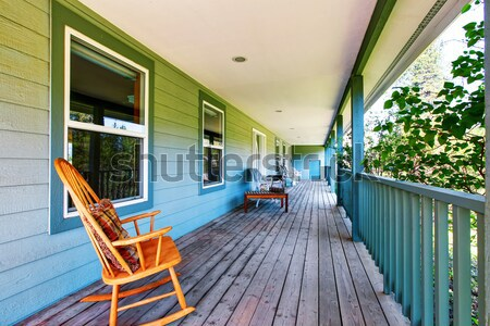 Front porch of the grey house with white railings and two windows. Stock photo © iriana88w