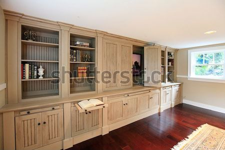 Bright kitchen interior with brown tile and cabinets. Stock photo © iriana88w