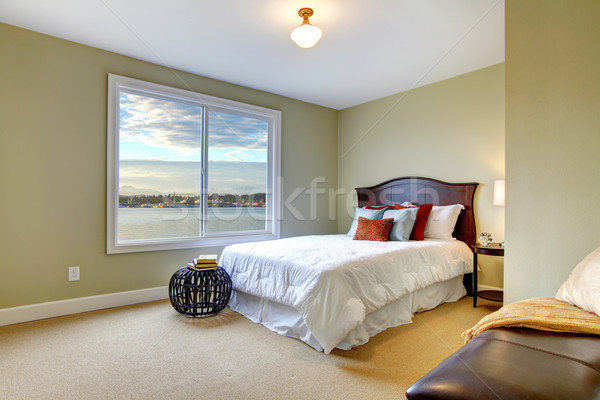 Green large bedroom with white bed and water view. Stock photo © iriana88w