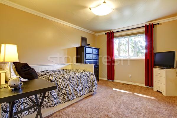 Bedroom interior with yellow walls and TV. Stock photo © iriana88w