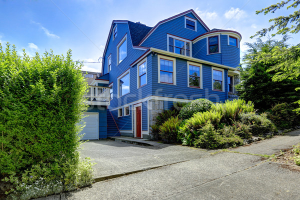 Big house exterior in blue color with red trim Stock photo © iriana88w