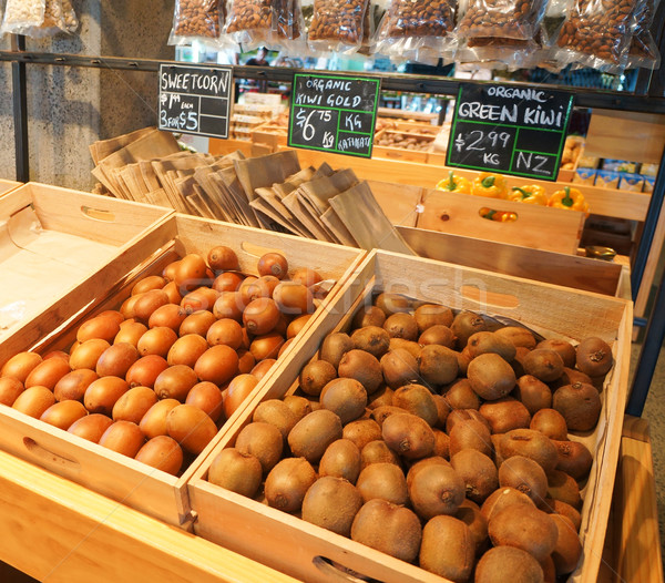 Boxes with golden and green kiwi at natural food market in Auckl Stock photo © iriana88w