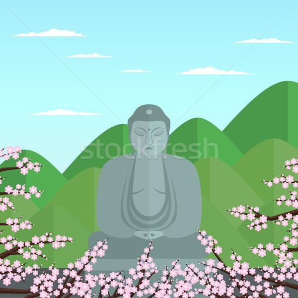 Buda stilize gri taş heykel yeşil Stok fotoğraf © Irinka_Spirid