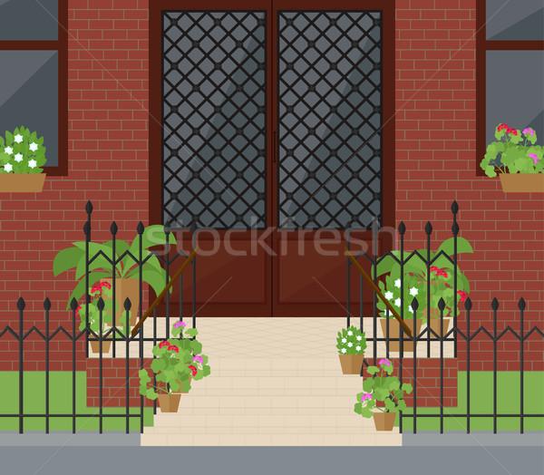 Przednie drzwi schody kwiaty wejście piękna drzwi Zdjęcia stock © Irinka_Spirid