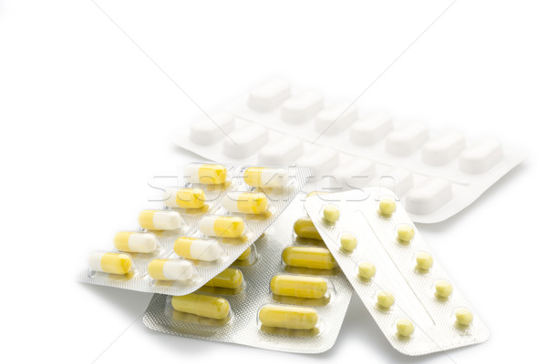 Jaune capsules pilule Pack blanche Photo stock © ironstealth