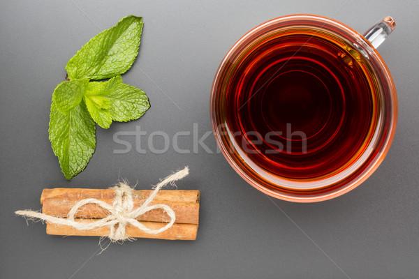 Vidro copo chá de canela em pau preto Foto stock © ironstealth