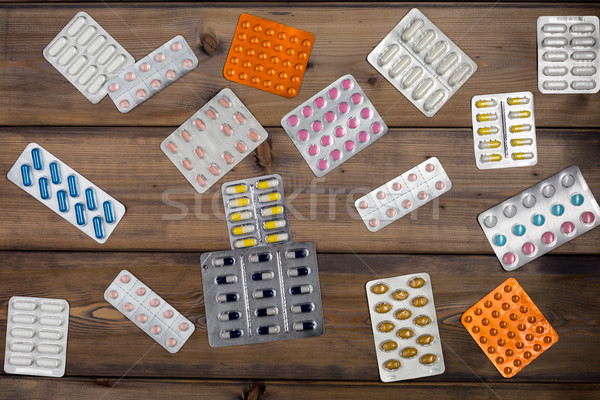 Pilule bouteilles Pack table en bois Photo stock © ironstealth
