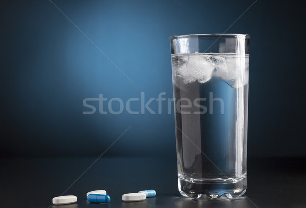 Medicine pills and glass of cold drink water Stock photo © ironstealth