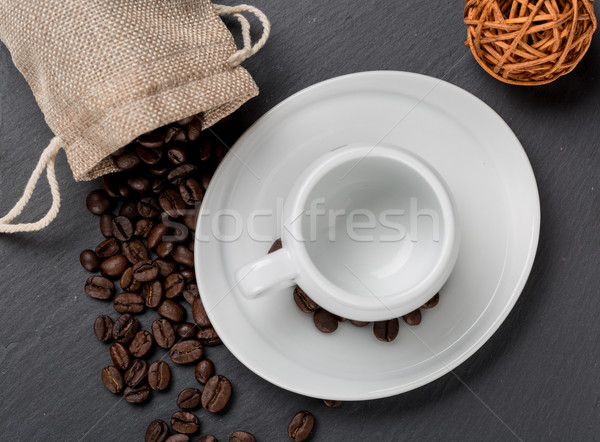Heap coffe beans and cup of fresh coffee Stock photo © ironstealth