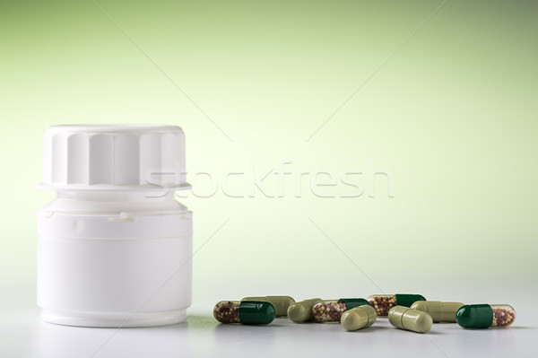 White pill bottle and various pills Stock photo © ironstealth
