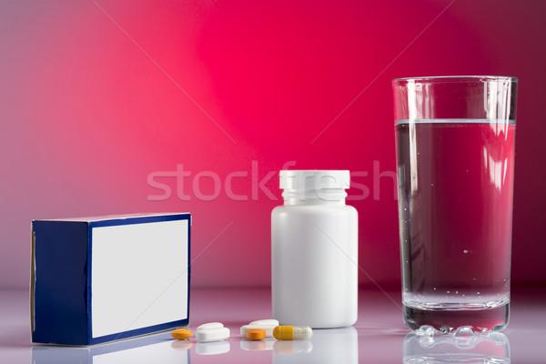 Pillole vetro acqua bottiglia colorato Foto d'archivio © ironstealth