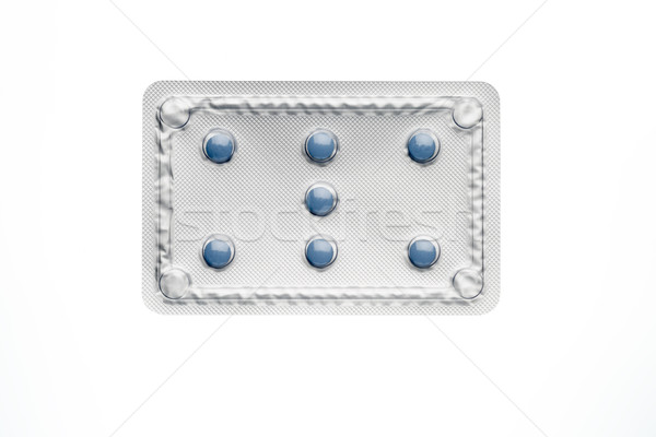 Blue pills in blister package isolated on white background. Stock photo © ironstealth