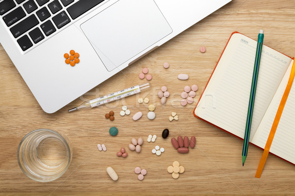 Anti virus set including pills and medicines on the workplace. Stock photo © ironstealth